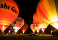 Multiple hot air balloons night glow Royalty Free Stock Photo