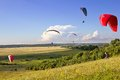 Multiple paragliders soar in the air Stock Photo