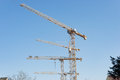 Multiple tower cranes at construction site