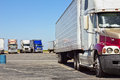 Multiple trucks park in a large parking lot Royalty Free Stock Image