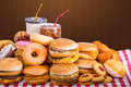 Multiple type of fast food on table Royalty Free Stock Photos