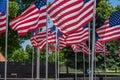 Multiple US Flags On Poles Wav...