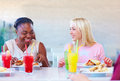 Multiracial female friends enjoying meal in restaurant Royalty Free Stock Photo