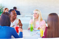 Multiracial female friends enjoying meal in restaurant happy Royalty Free Stock Images