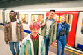 Multiracial group of hipster friends having fun in tube subway Royalty Free Stock Photo