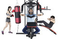 Multiracial people workout on weights machine Royalty Free Stock Photo