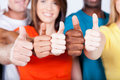 Multiracial thumbs up Stock Image