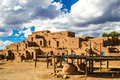 Multistoried taos pueblo unesco world heritage site with baking ovens in foreground Royalty Free Stock Photo