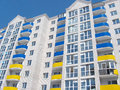 Multistory modern house in blue and yellow colors Royalty Free Stock Photo
