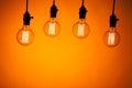 Multitude of bulb lamps on orange background Stock Image