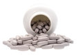Multivitamins spilling from plastic bottle Royalty Free Stock Photo