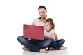 Mum with a daughter at the laptop on white Stock Photography