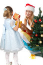 Mum and the daughter near a Christmas tree Royalty Free Stock Photo