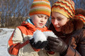 Mum with the son play with snow outdoor Stock Images