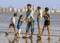 Mumbai family at the beach an indian frolicks on in india Stock Photography