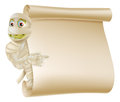 Mummy halloween monster scroll sign an illustration of a character peeping round a or banner and pointing at it Stock Image