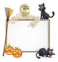 Mummy halloween sign a with a classic character pointing down and witch s black cats broomstick and carved orange Royalty Free Stock Image
