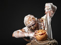 The mummy holding the pumpkin Royalty Free Stock Image