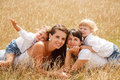 Mums and kids two two lying in dry grass Royalty Free Stock Photo