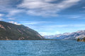 Muncho lake british columbia canada this very large deep blue lake is known for its great fishing as well as its beauty Royalty Free Stock Photo