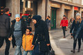 Munich, Germany, December 29, 2016: A friendly family of migrants walks down the street in Munich. Tolerance