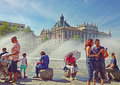Munich germany summer at karlsplatz june hot weather in more than celsius people look for refreshment near the fountain stachus Royalty Free Stock Photos