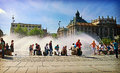 Munich germany summer at karlsplatz june hot weather in more than celsius people look for refreshment near the fountain stachus Stock Images