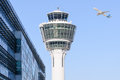 Munich international airport control tower and departing taking off Royalty Free Stock Photo