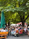 Munich people at a typical op nir restaurant seat and enjoy beer and food open air viktualien markt in Royalty Free Stock Images