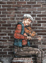Mural of a fiddler on brick wall Royalty Free Stock Photos