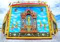 Mural and sculpture thai style on the wall of buddhist temp temple in thailand Royalty Free Stock Image