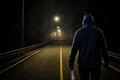 Murderer standing on the street at night Royalty Free Stock Photo