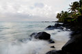 Muri lagoon in rarotonga cook islands sea waves breaks on black rocks at during sunrise Royalty Free Stock Photography