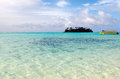 Muri lagoon in rarotonga cook islands yellow boat and mall coral islet at Royalty Free Stock Image