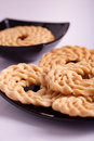 Murukku is a savoury snack from india popular in south Stock Photo