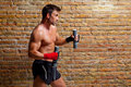 Muscle boxer man with fist bandage and weights Royalty Free Stock Photo