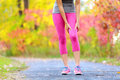 Muscle injury of female sports runner thigh woman running strain in closeup touching leg in Royalty Free Stock Photography