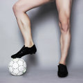 Muscle male legs with ball Royalty Free Stock Photo