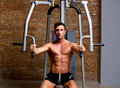 Muscle man exercise on sport gym fitness club Royalty Free Stock Photo