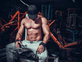 Muscle shaped man tired sitting relaxed Royalty Free Stock Photo