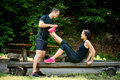 Muscle spasm after sport training man stretches womans leg Stock Photos