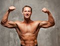 image photo : Muscle sportsman on a grey background