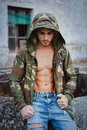 Muscled boy with camouflage jacket Royalty Free Stock Photo