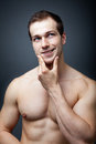 Muscles or brain? Muscular man thinking Royalty Free Stock Image