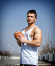 Muscular american football with ball in hand. Royalty Free Stock Photo