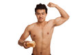 Muscular asian man load carbs with some bread flexing biceps isolated on white background Stock Images