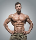 Muscular athlete bodybuilder man on a gray background Royalty Free Stock Photo