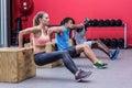 Muscular athletes doing reverse push up Royalty Free Stock Photo