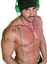 Muscular athletic tanned and shirtless man with headphones isolated on white Stock Image