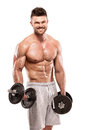 Muscular bodybuilder guy doing exercises with big dumbbell over white background Royalty Free Stock Photos